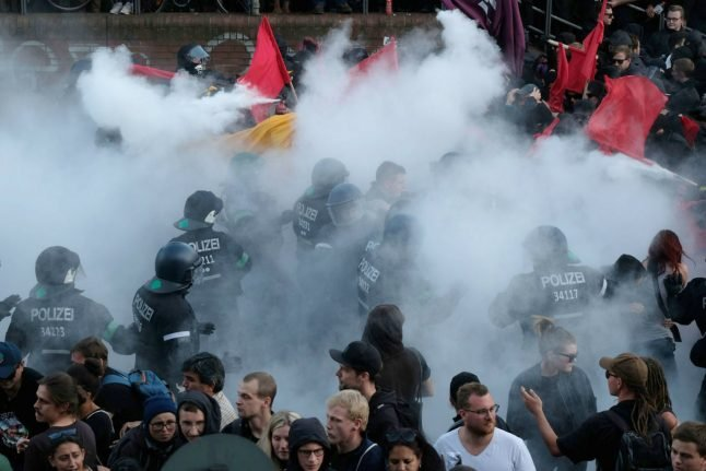 AS IT HAPPENED: Cars burn after police break up first major G20 protest with water cannons
