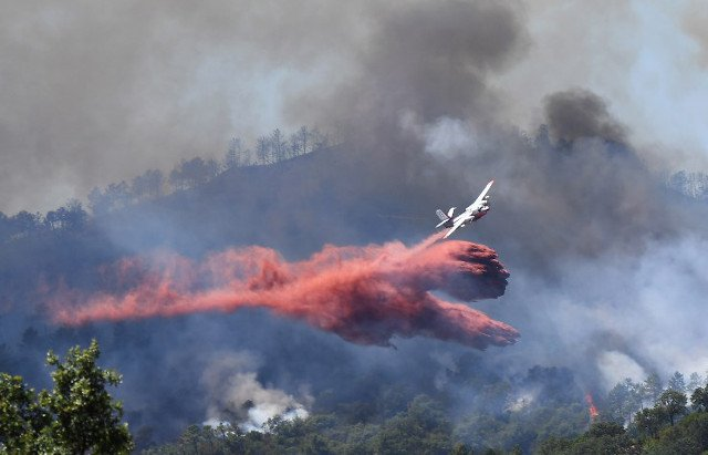 Ten thousand flee raging wildfires in southern France