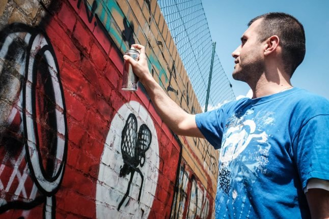 How Berlin activists are turning Nazi hate graffiti into art