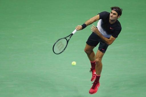 Federer sets up quarterfinal showdown with Del Potro