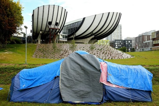 French university cancels lectures after migrants set up home on campus