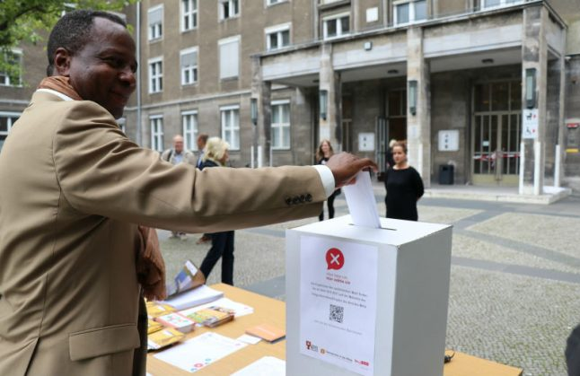 Foreigners cast symbolic ballots in new initiative to give voting rights to all