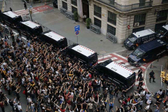 Catalan hotels evict Spanish police as crowds protest violence at the polls