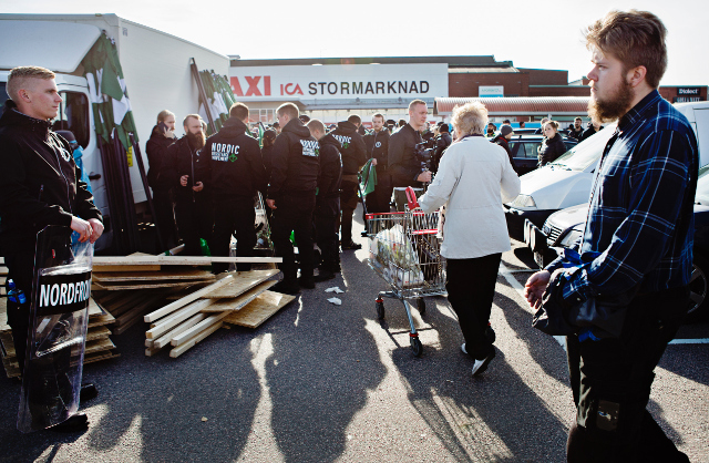 Watch: Elderly Swedish shopper totally undeterred by neo-Nazis