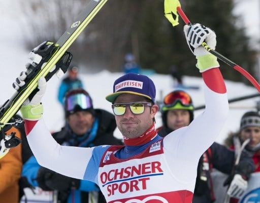 Swiss ski champ Feuz wins season opener in Canada