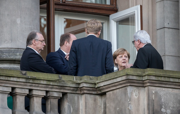 German parties vow to drop the insults in push to forge new Merkel government