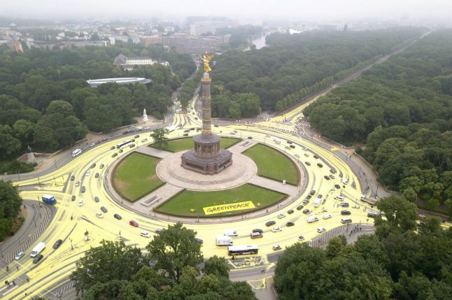 Greenpeace colour streets of Berlin yellow to protest against coal