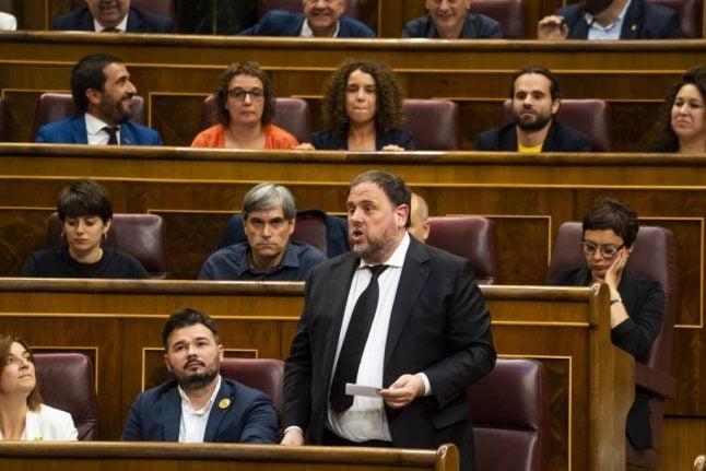 Spanish parliament suspends four jailed Catalan MPs