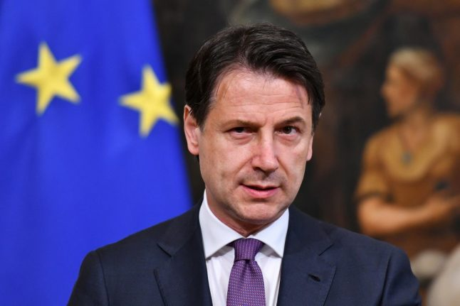 Italy 'absolutely determined' to avoid EU sanctions over debt: PM