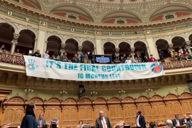 Singing climate activists disrupt Swiss parliament