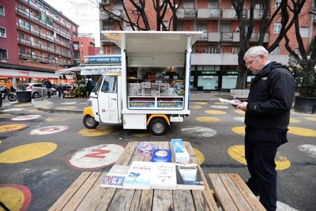 How a three-wheeled newsagent hopes to help keep Italians reading
