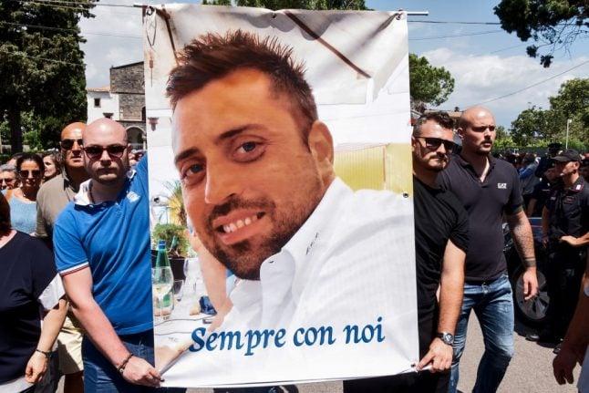 American murder suspect says Italian police beat him in custody