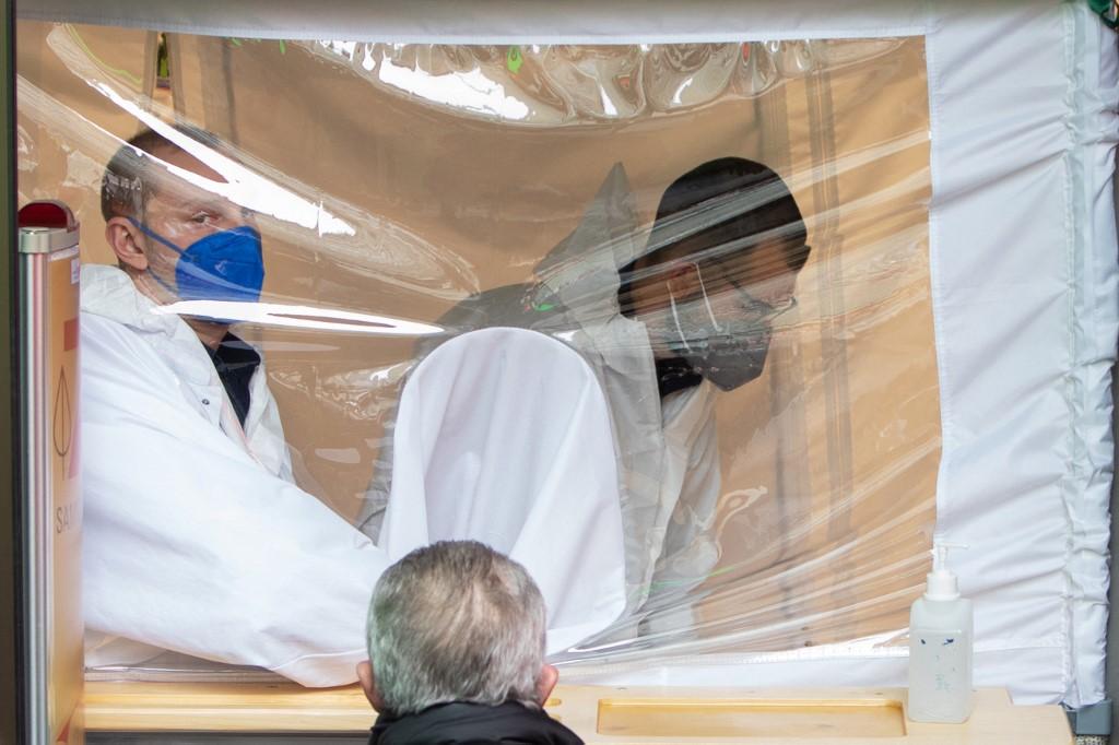 Pharmacists carry out coronavirus tests in Austria ALEX HALADA
