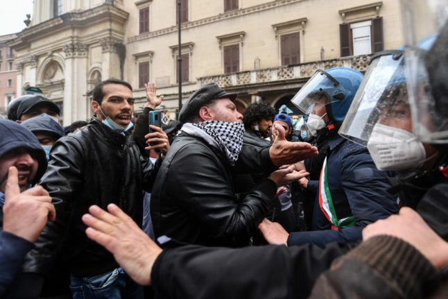 Covid-19: Protesters clash with Italian police over business closures