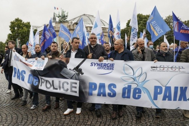 Why are French police demonstrating in Paris?
