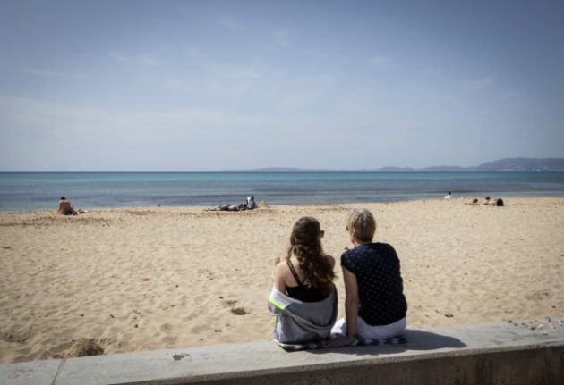 TRAVEL: Which regions in Spain offer free insurance to tourists who get Covid-19 while on holiday?