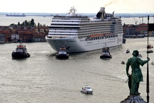 Venice bans large cruise ships from centre after Unesco threat of 'endangered' status