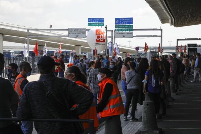 Striking workers block Paris airport terminal, flights delayed