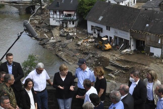 Germany's Merkel sees 'surreal' wreckage as Europe flood death toll tops 180