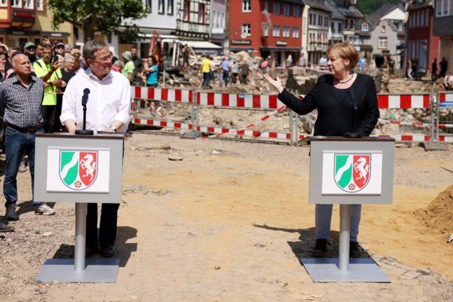 POLITICS: Frontrunner to succeed Merkel as chancellor on back foot after flood disaster