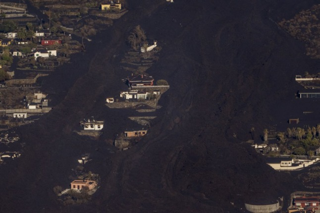 Lava flow from Spain's La Palma volcano briefly stops as many remain confined over toxic gas fears