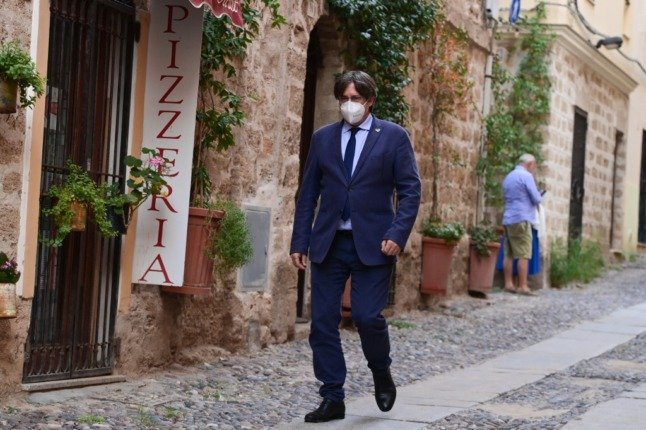 Catalan separatist leader returns to Brussels with Spain's extradition request hanging in the balance