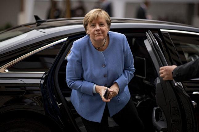 Germany's Scholz gets Merkel boost in coalition battle