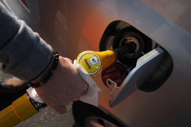 A motorist fills the tank of his car with diesel. Diesel prices in France have surpassed the record set in 2018.