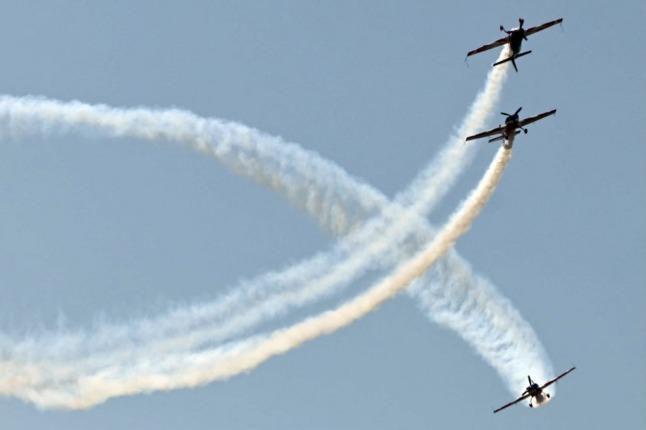 French aerobatics champ makes emergency landing in field