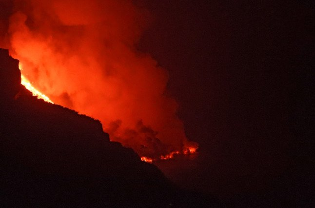 Ringside seat for fearful villagers as La Palma volcano spews fire