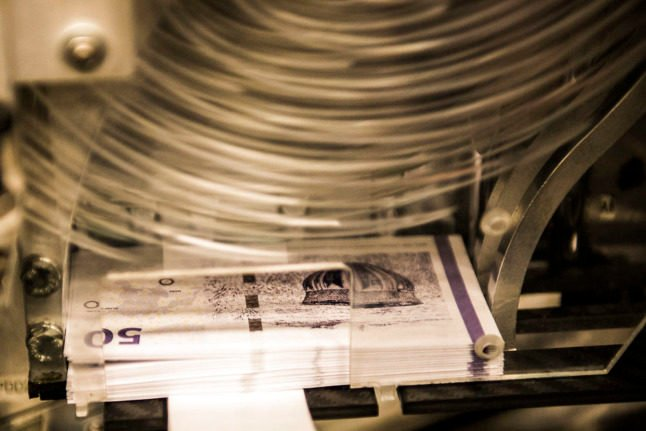 Denmark's central bank decreases interest rates in response to strong currency